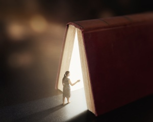 Woman is lost and wanders into a book with glow lights.