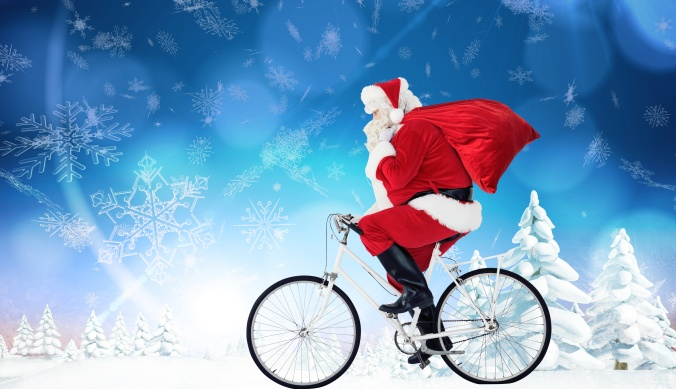 Composite image of santa claus delivering gifts with bicycle